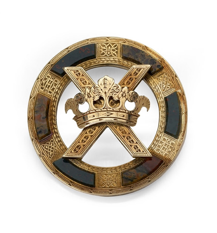 A Victorian gold mounted Scottish pebble brooch