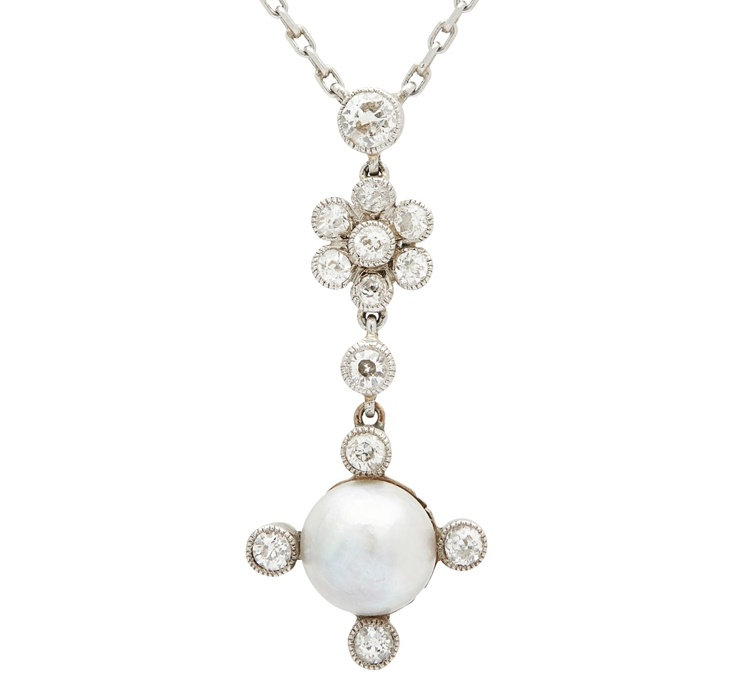 A natural pearl and diamond set pendant necklace