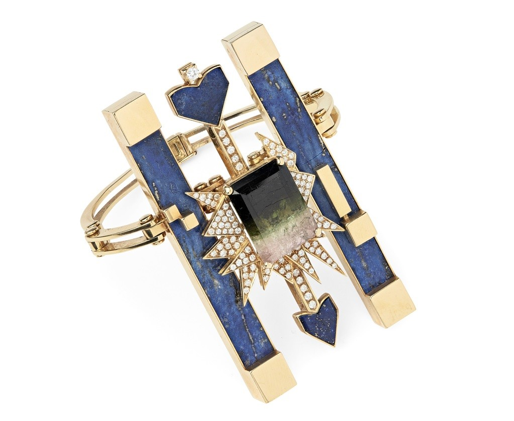 A contemporary multi-gem set abstract bracelet