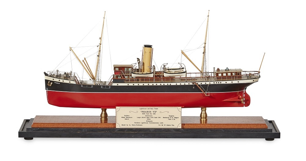 LOT 199 | A CASED MODEL OF A LIGHTHOUSE AND BUOY TENDER | PHAROS VII 1909 | built by A. J. Berry Robinson, for Mr W. Adams, the ship supplied to The Commissioners of The Northern Lighthouse Board, in a brass framed glazed display case with engraved plaque | 61cm length of model | £1,500 - £2,000 + fees