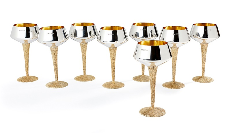 § Stuart Devlin A.O. C.M.G. (Australian/British 1931-2018) Set of Eight Wine Stemmed Goblets, 1969 1969, the bowls with gilt interior and inverted rim, all raised on an inverted tapering textured silver gilt stems to a spreading foot  (Qty: 8)  17.7cm high (6.95in high), 78.4oz (all in)  Sold for £4,250