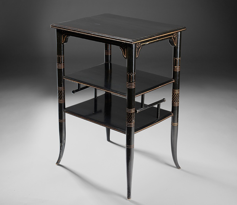 LOT 35 | E. W. GODWIN (1833-1886), PROBABLY FOR GILLOW & CO. | AESTHETIC MOVEMENT 'COFFEE TABLE', CIRCA 1880 ebonised birch with incised and gilded decoration | 48cm long, 69.5cm high, 37.5cm deep | Sold for £17,500 incl premium