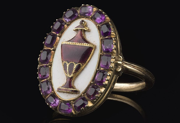 A George IV enamel and amethyst mourning ring