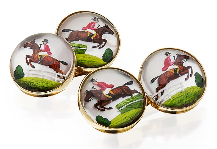 A pair of Essex crystal cufflinks the circular terminals set in unmarked yellow metal, each depicting a horse and huntsman mid-jump