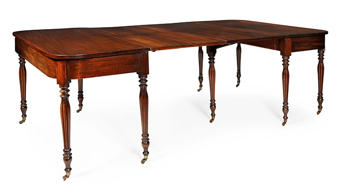 LOT 223 | GILLOWS STYLE MAHOGANY DINING TABLE | 19TH CENTURY with rounded rectangular top, one end with a gateleg, raised on reeded tapered legs and wood castors | 230cm wide, 74cm high, 121cm deep | £600 - £800 + fees