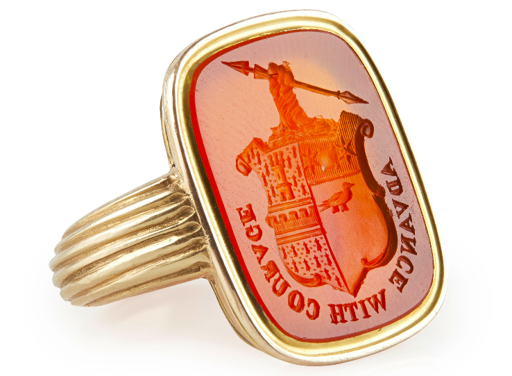 AN EARLY 19TH CENTURY GENTLEMAN'S ARMORIAL CORNELIAN RING