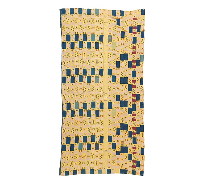 LOT 180 | EARLY EWE CLOTH | TOGO / EASTERN GHANA strip woven cotton, formed of twenty strips, navy blocks on an cool yellow ground, the central strip unadorned and signed, the design becoming irregular on the opposing side, weft float motifs throughout 304cm x 155cm | £300 - £500 + fees Provenance: The Keir McGuinness Collection of African Textiles