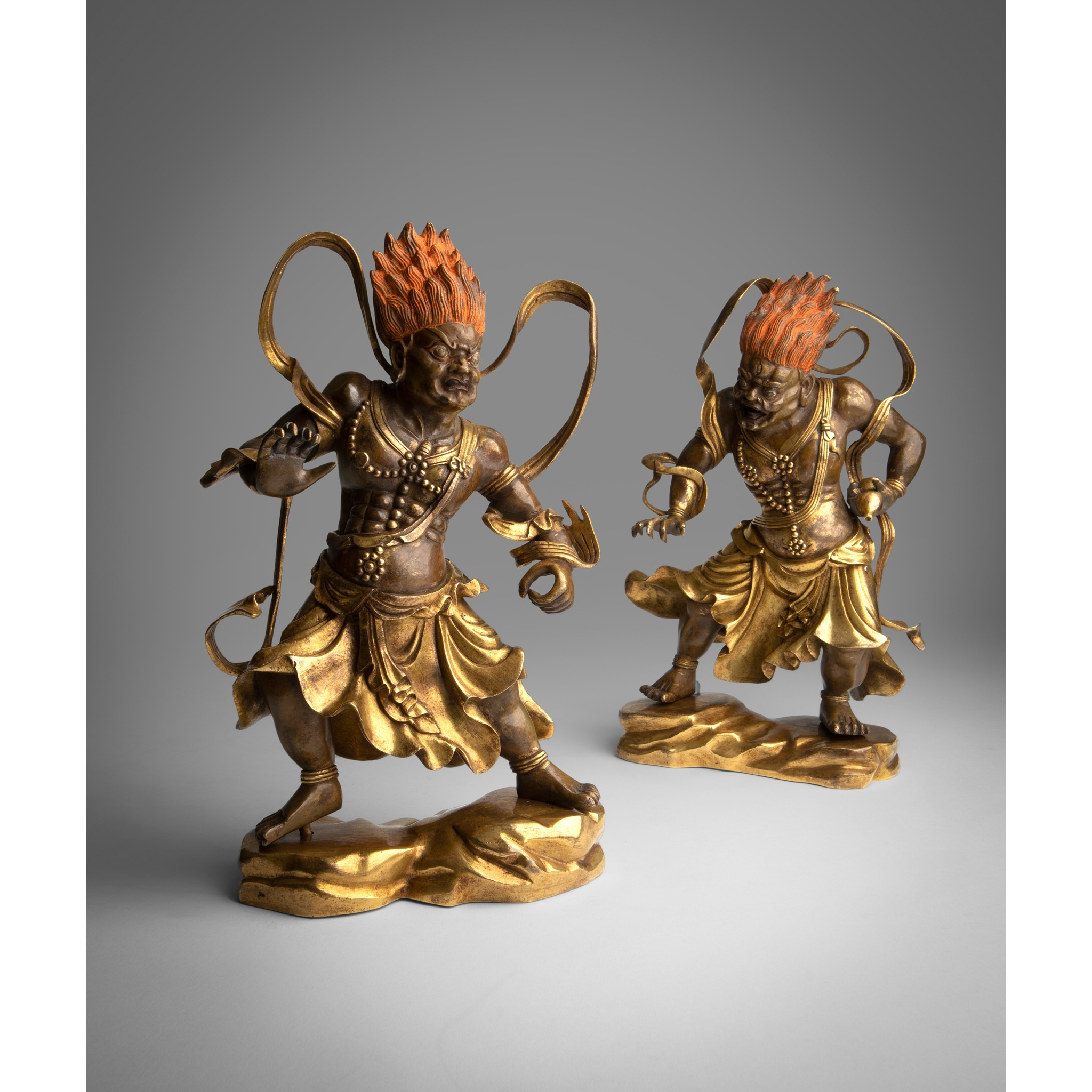 PAIR OF GILT BRONZE FIGURE OF TEMPLE GUARDIANS QING DYNASTY, 18TH CENTURY
