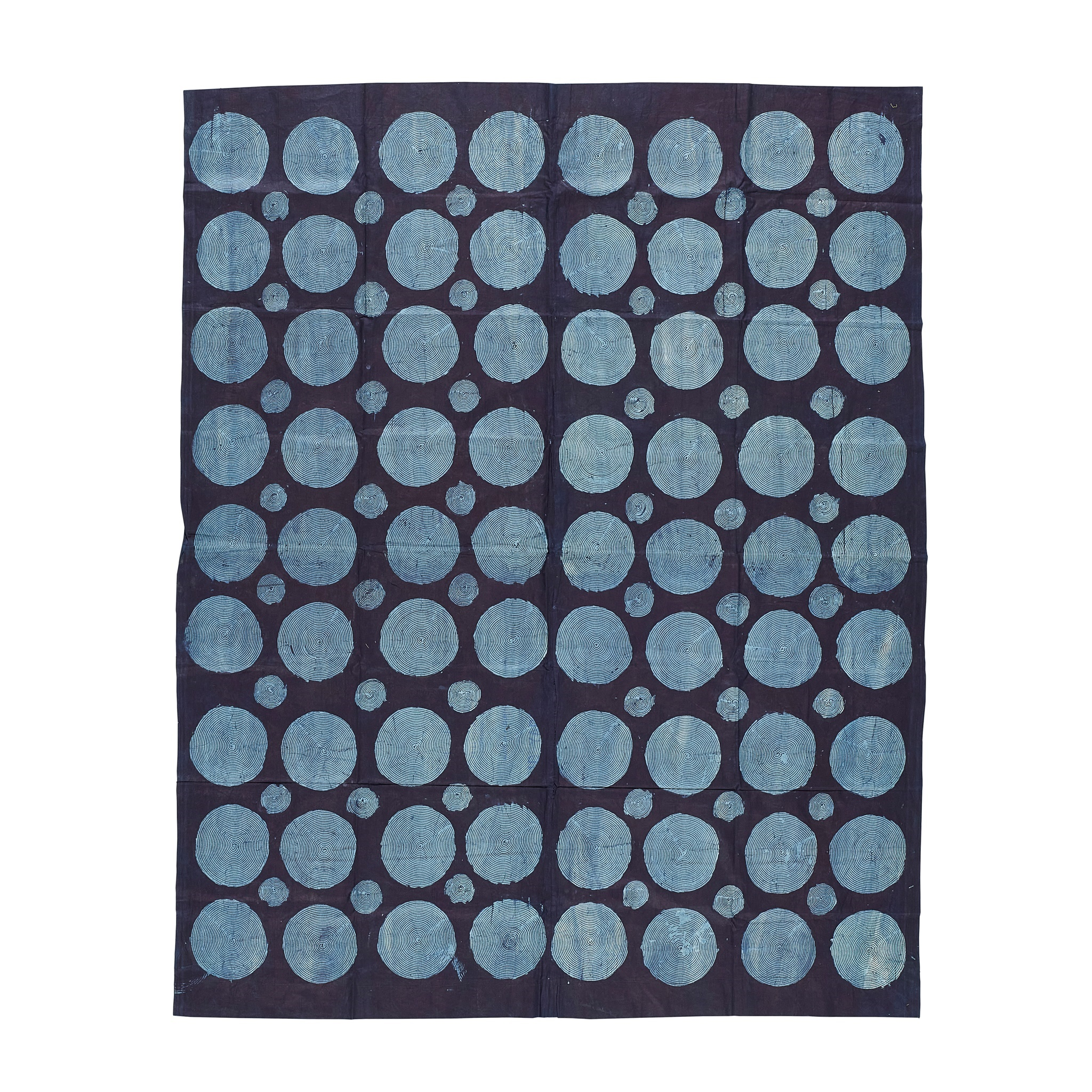 LOT 192 | YORUBA ADIRE TEXTILE | NIGERIA dyed cotton, with rows of light blue circles on a navy ground 204cm x 173cm | Sold for £2,750 + fees Provenance: The Keir McGuinness Collection of African Textiles