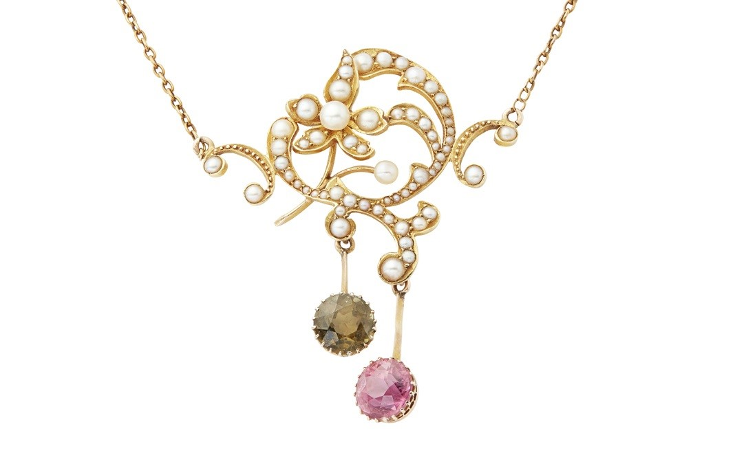 An Edwardian seed pearl and tourmaline set pendant