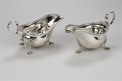 Lot 335 - A pair of silver sauceboats, Walker & Hall Ltd., Sheffield, 1934