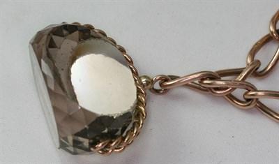 Lot 39 - A 9ct rose gold bracelet suspending three large swivel fobs