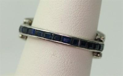Lot 42 - An early 20th century multi-gem set swivelling full-eternity ring