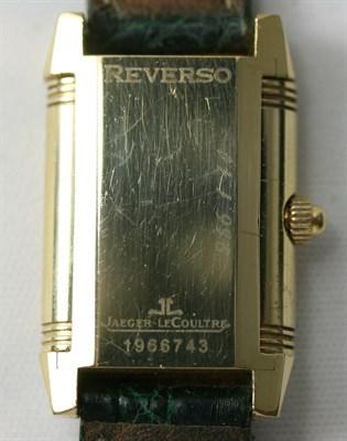 Lot 115 - JAEGER-LE COULTRE - a lady's 18ct gold diamond set Reverso wrist watch