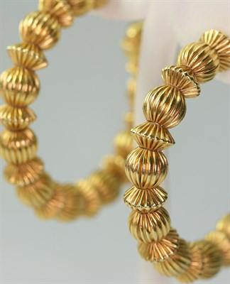 Lot 81 - A pair of 18ct gold Creole style earrings, probably by Ilias Lalaounis