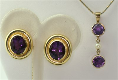 Lot 121 - PALOMA PICASSO FOR TIFFANY & CO - a pair of 18ct gold mounted amethyst set earrings