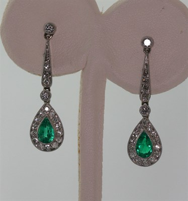 Lot 104 - A pair of emerald and diamond set pendant earrings