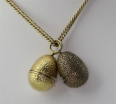 Lot 120 - STUART DEVLIN - two 1970's ovoid lockets with chain