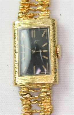 Lot 119 - A mid-20th century lady's gold wrist watch