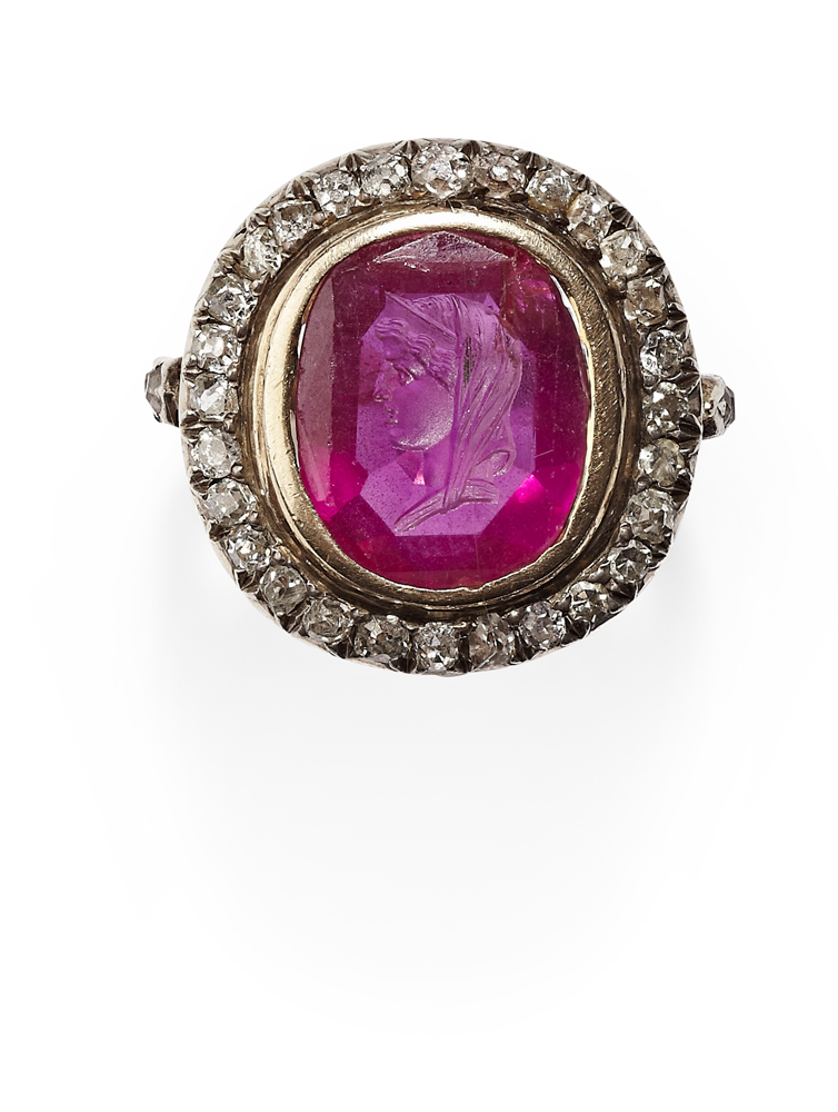 Lot 109 - A seal carved ruby and diamond set cluster ring