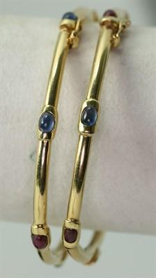 Lot 131 - A pair of multi-gem set bracelets