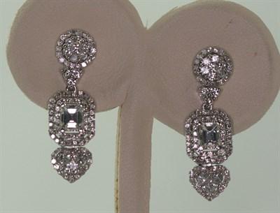 Lot 69 - A pair of diamond set pendant earrings