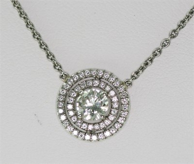 Lot 52 - A diamond cluster pendant with chain