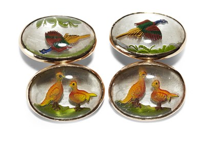 Lot 25 - A pair of Edwardian reverse painted crystal intaglio set cufflinks