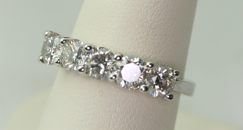 Lot 49 - An 18ct white gold mounted five stone diamond ring