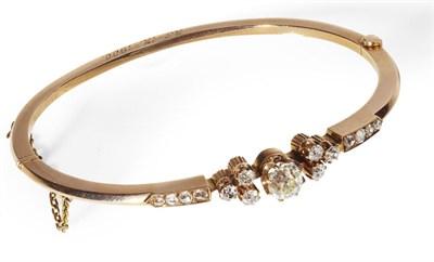 Lot 19 - A Victorian 18ct gold diamond set bangle