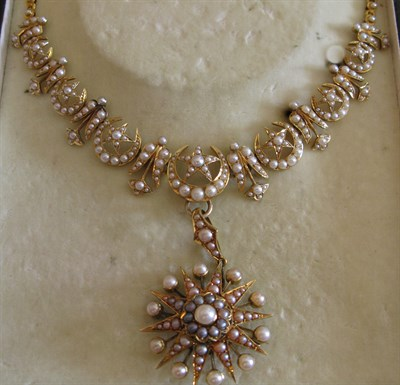 Lot 14 - An Edwardian gold and pearl set necklace