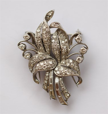 Lot 170 - An early 20th century diamond set pair of clips/brooch