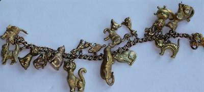 Lot 130 - A 9ct gold charm bracelet