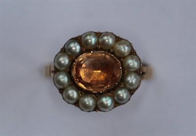 Lot 12 - A Georgian topaz and half-pearl set ring