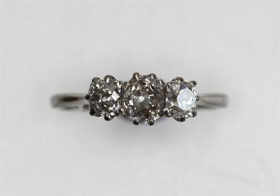 Lot 208 - A three-stone diamond ring
