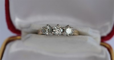 Lot 209 - An 18ct gold mounted three-stone diamond ring