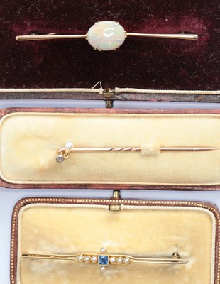 Lot 116 - Two gem set bar brooches and a stick pin
