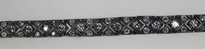 Lot 159 - An Art Deco 18ct white gold and platinum mounted diamond set bracelet