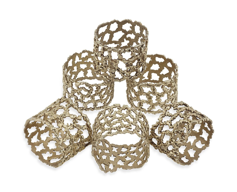 Lot 632 - STUART DEVLIN - A set of six modern silver gilt napkin rings