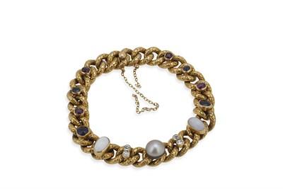 Lot 13 - A Edwardian multi-gem set gold bracelet