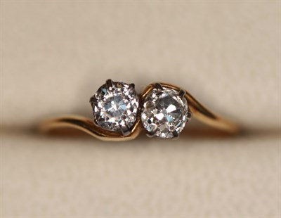 Lot 172 - A two stone diamond ring