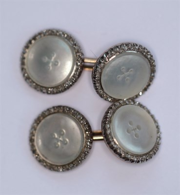 Lot 86 - A pair of early 20th century mother-of-pearl and diamond set cufflinks