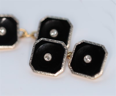 Lot 106 - An early 20th century pair of 18ct gold and platinum mounted onyx and diamond set cufflinks
