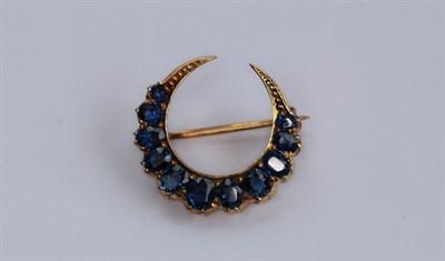 Lot 28 - A Victorian sapphire set crescent brooch