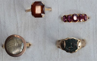 Lot 60 - A group of various gem set rings to include