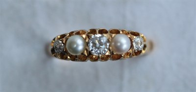 Lot 32 - An 18ct gold, pearl and diamond ring