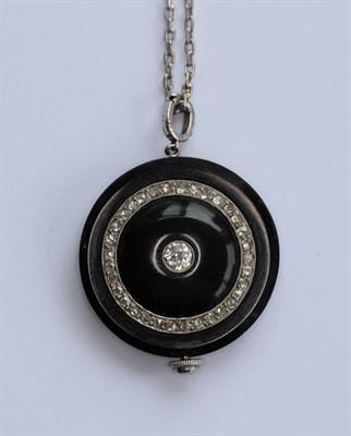 Lot 42 - A Cartier style diamond, onyx pendant watch