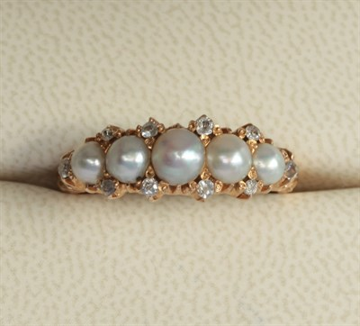 Lot 38 - A pearl set ring