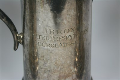 Lot 658 - A pair of silver plated flagons
