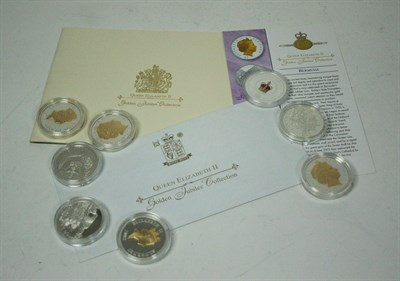 Lot 631 - A collection of twenty four silver proof and gilt crown sized coins